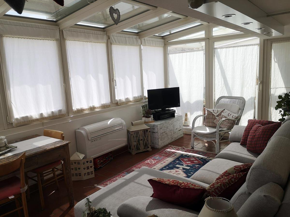 Veranda in PVC e alluminio Finstral